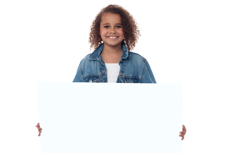 Smiling cute girl with blank white board photo