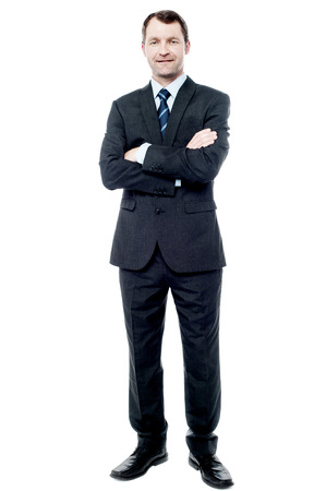 Handsome businessman in suit with crossed arms Stock Photo