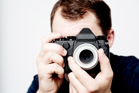 say cheese: Man taking photo with professional camera, focus on hand