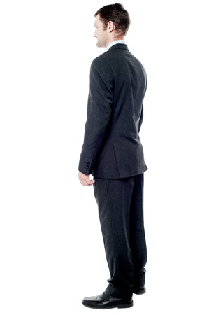 Full length rear view image of a businessman photo