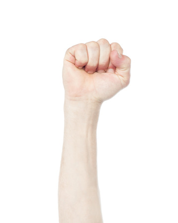 Image of clenched fist, isolated on a white photo