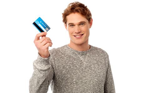 debit card: Handsome casual man holding his debit card Stock Photo