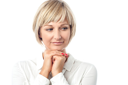beautiful middle aged woman: Beautiful middle aged woman thinking and looking away
