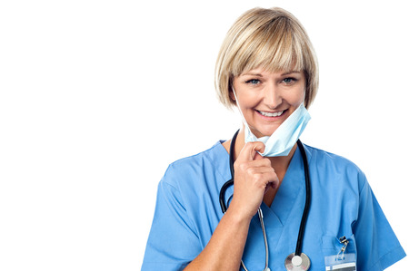 Experienced lady doctor removing her surgical mask photo