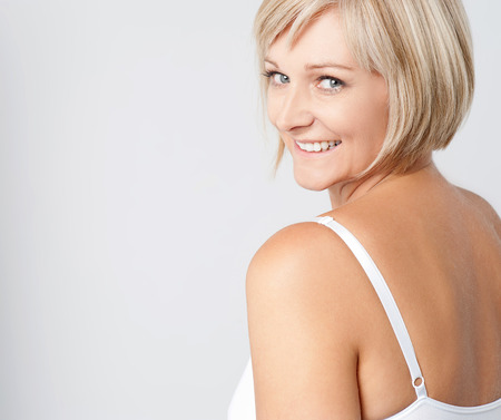 Beautiful middle aged woman smiling warmly Stock Photo