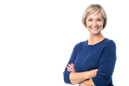 white  background: Attractive middle aged woman with folded arms