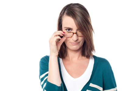 beautiful middle aged woman: Beautiful middle aged woman adjusting her eyeglasses