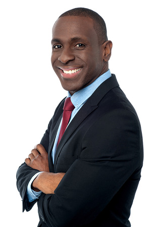 Handsome african businessman with folded hands