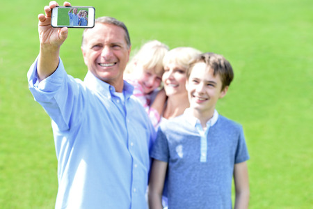 capturing: Happy family capturing memorable moment