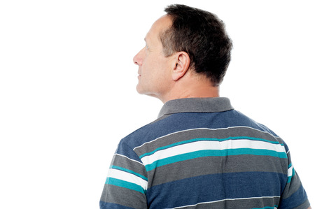 Rear view of a mature man looking up at something photo