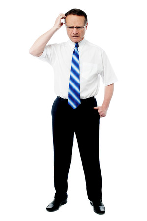 Mature businessman scratch his head, isolated on white photo