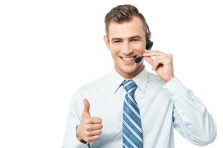 Smiling customer support executive on call