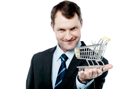 shopping cart isolated: Businessman with the shopping cart isolated on white Stock Photo
