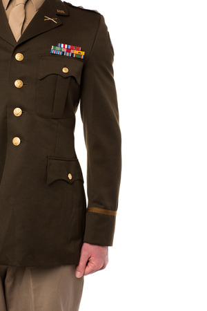 Young man in military uniform, cropped image photo