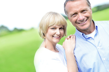 beautiful middle aged woman: Happy middle aged couple posing together at outdoors