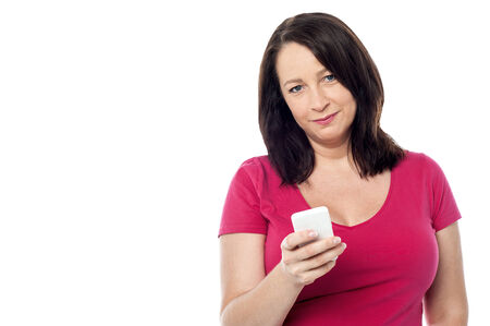 Middle aged woman texting on her cell phone photo