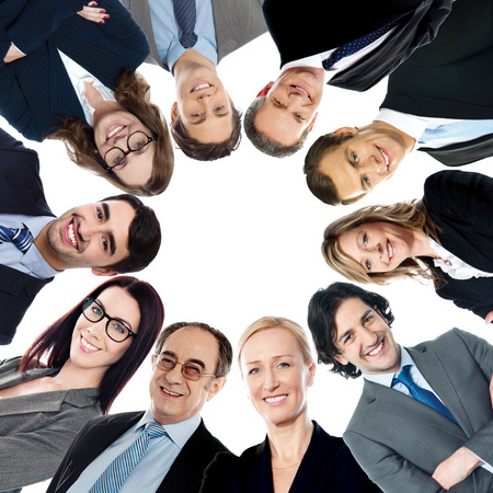 Circular formation of smiling business people photo
