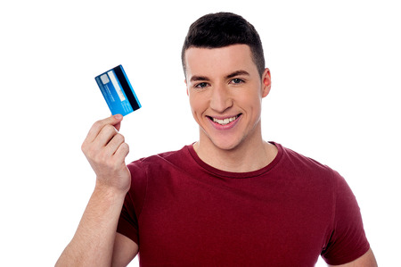 debit card: Handsome man showing his debit card Stock Photo