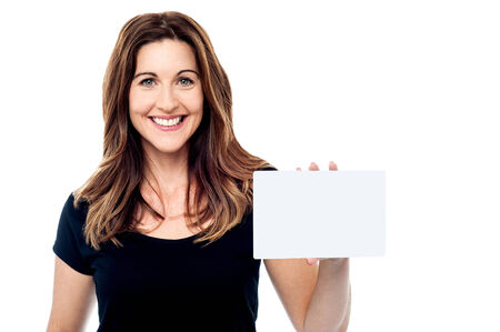 Beautiful woman holding a business card isolated on white photo