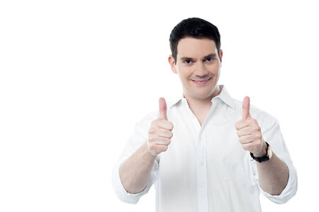 posing  agree: Happy middle aged man showing double thumbs up Stock Photo