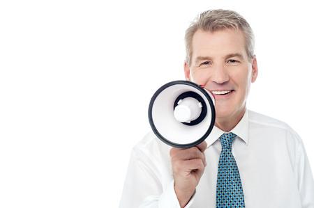 making an announcement: Businessman making announcement over a loudhailer Stock Photo