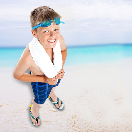 Aerial view of boy in swimming goggles on beach background photo