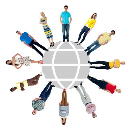 Multi-ethnic people standing around the globe sketch photo