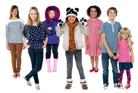 Group of kids standing together in trendy attire photo