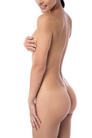 nude female buttocks: Beautiful naked woman covering her bare body
