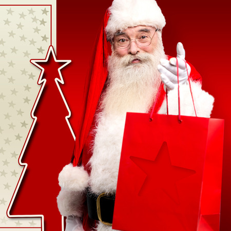 saint nick: Christmas saint giving away gifts and welcoming the eve Stock Photo
