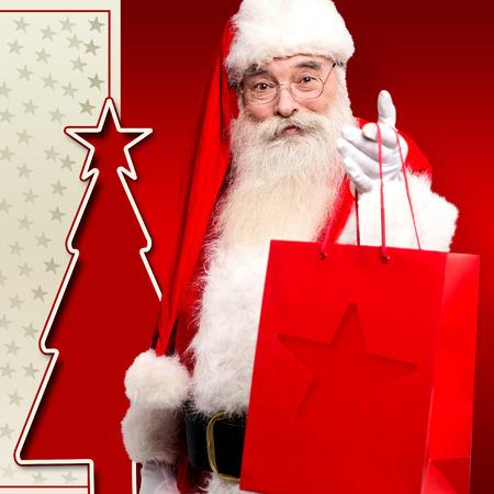 saint nick: Christmas saint giving away gifts and welcoming the eve Stock Photo