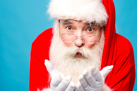saint nick: Santa claus holding something in his hands Stock Photo