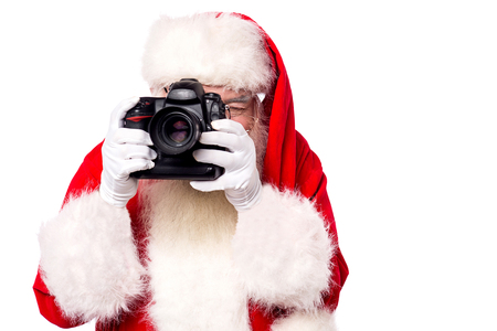 saint nick: Santa-claus taking picture with his new camera Stock Photo