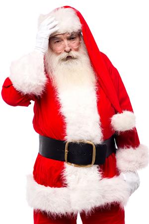 saint nick: Worried santa claus holding hand on his forehead