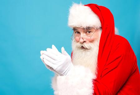 saint nick: Image of santa-claus ready to blow snow looking at camera Stock Photo