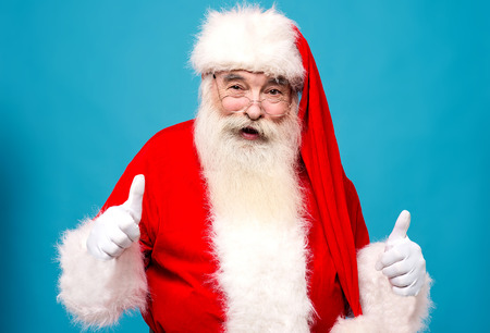 saint nick: Confident santa claus showing thumbsup