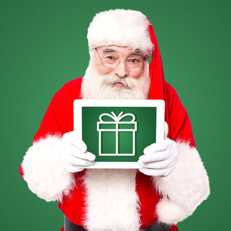 Santa displaying his tablet pc gift for lucky winner photo