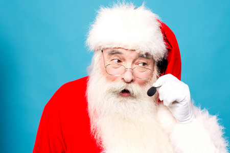 saint nick: Santa with headset sharing christmas wishes to the callers