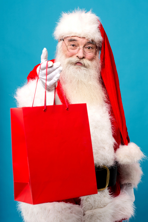 saint nick: Santa distributing gifts for Christmas eve