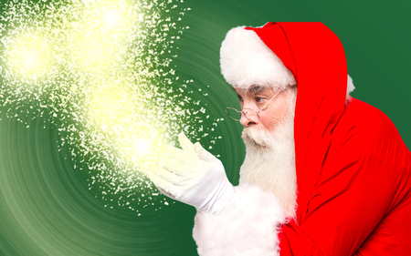 saint nick: Santa holding magical lights in hands
