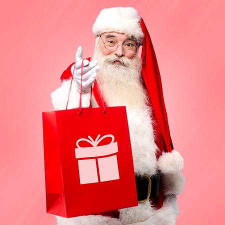 saint nick: Santa claus distributing gifts to all on Christmas eve Stock Photo