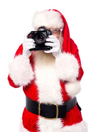 サンタ クロースの彼の新しいカメラで写真を撮って