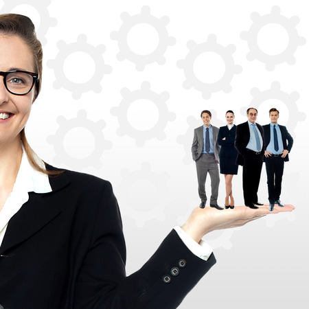 Business team standing together on woman Stock Photo