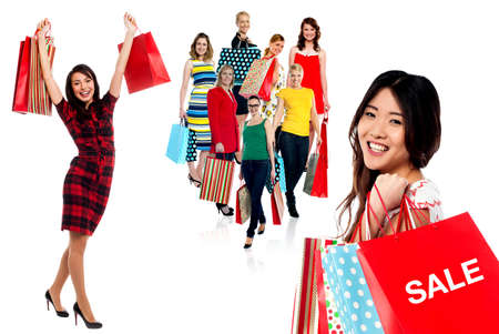 Smiling women with colorful shopping bags photo