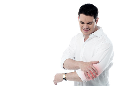 reddening: Young man having pain in his elbow Stock Photo