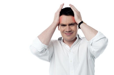 reddening: Troubled man suffering from headache Stock Photo