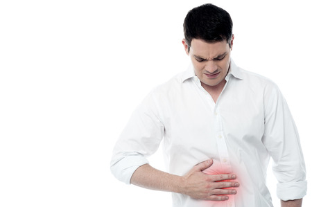 abdomen: Stomach ache, man placing hand on the spot.
