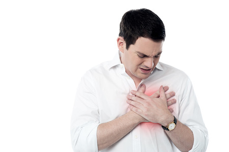 Man suffering from chest pain, heart attack.