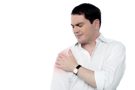 middle joint: Middle aged man suffering from shoulder pain Stock Photo