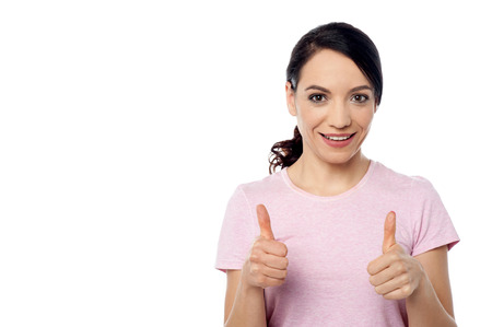 posing  agree: Young woman showing thumb up by two hands